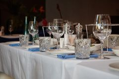 Table in the restaurant, served with wine glasses and ready to welcome guests.  royalty free stock images