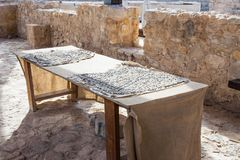 The table is restored with mosaic fragments in The Good Samaritan Museum Near Kfar Adumim in Israel stock photography