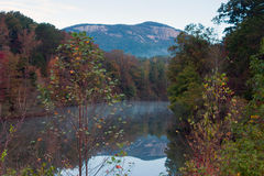 Table Rock,. Table Rock mountain reflecting in a lake early morning, Fall colors, North of Pickens, South Carolina, elevation app. 3,124ft 3rd highest in South Royalty Free Stock Images