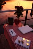 Table for a romantic marriage at the lake. Table for a marriage with candles Royalty Free Stock Photos