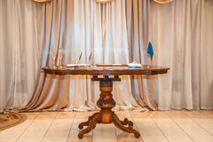 Table in the room. Carved wooden table standing in the room Stock Photos
