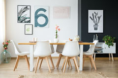 Table in a room. Wooden table with flowers in spacious bright room Stock Photography