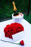 Champagne and roses with a note Stock Images
