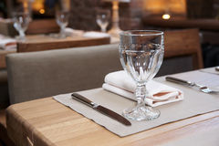 Table in a rustic cuisine restaurant Royalty Free Stock Images