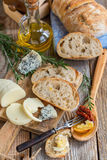 Table with rustic snacks and homemade bread. Royalty Free Stock Photography
