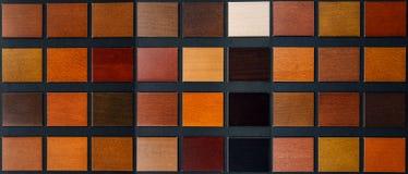 Table of samples of veneered wood royalty free stock image