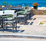 Table in santorini europe greece old restaurant chair and the su Royalty Free Stock Image