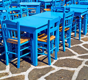 Table in santorini europe greece old restaurant chair and the su Royalty Free Stock Images