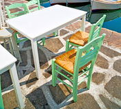 Table in santorini europe greece old restaurant chair and the su Stock Photography