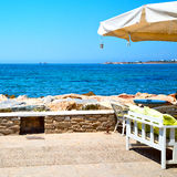 Table in santorini europe greece old restaurant chair and the su Royalty Free Stock Photo