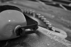 Table saw and earmuffs Royalty Free Stock Image