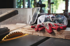Table saw and safety gloves Royalty Free Stock Images