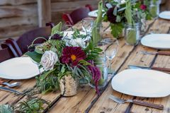 Table scape with dark red florals stock photography