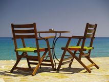 Table at the sea. Table with two chairs at the sea Royalty Free Stock Images