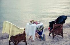 Table on seacoast Stock Photos