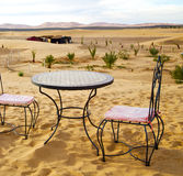 Table and seat in desert  sahara morocco    africa yellow sand Stock Photo