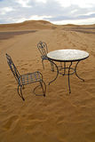 Table and seat in   morocco    africa yellow sand Stock Photos