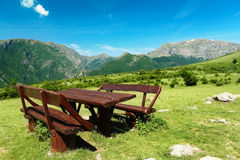 Table and seats in the high mountains of Bulgaria Stock Photos