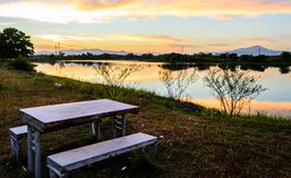 Table seats at lakeside Stock Photography