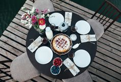 Table served for breakfast with delicious homemade pie, berries,