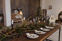Table served for Christmas dinner in living room wiyj Christmas tree. Table served for Christmas dinner in living room Stock Photography
