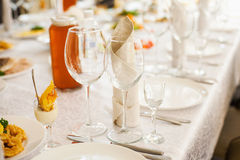 Table served with different food and flatware Royalty Free Stock Photo