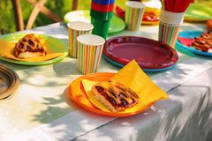 Table served with disposable tableware. Closeup Stock Photography