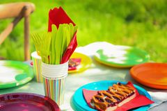 Table served with disposable tableware. In garden Royalty Free Stock Photo