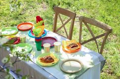 Table served with disposable tableware. In garden Stock Photo