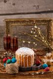 A table served for Easter. Fresh Russian cake and dyed quail eggs on a wooden background. With an ancient frame in the background. Easter greeting card. A table Royalty Free Stock Photos