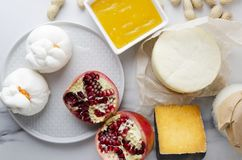 Table served with gouda,provolone,ricotta,buratta,peanuts,pomegranates,honey for tasty dinner.Top view of served table,plenty of g royalty free stock photography