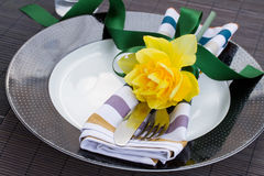 Table serving with daffodil flower Royalty Free Stock Photo