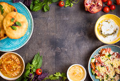 Table served with middle eastern vegetarian dishes. Hummus, tahi Royalty Free Stock Photo
