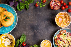 Table served with middle eastern vegetarian dishes. Hummus, tahi Stock Image