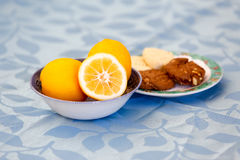 Table served with oranges and  cookies for a snack Royalty Free Stock Image
