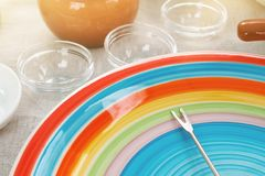 Table served for outdoor picnic with colored plate in the foreground. Table served for outdoor picnic with colored plate and skewer in the foreground. Toned Stock Photos