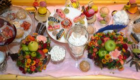 Table served sweet dessert and fruits Stock Images