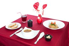 Table with served table with breakfast and drink, tablecloth red, cutlery.. Close up, indoor royalty free stock photo