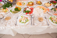 Table served with tasty meals Royalty Free Stock Photography