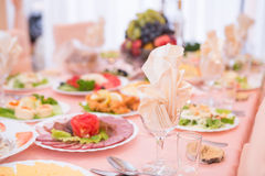 Table served with tasty meals Stock Photo