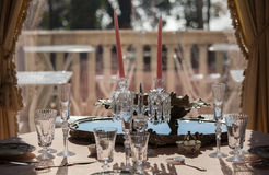 Table service and glasses in a luxurious villa Royalty Free Stock Photo
