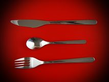 Table serving-dishware on red backdrop. Royalty Free Stock Photos
