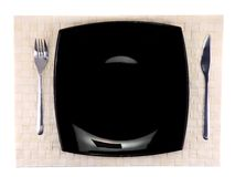 Table serving-knife,plate,fork on colour backdrop. Royalty Free Stock Photography