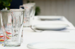 Glasses. Table set up for serving Stock Image