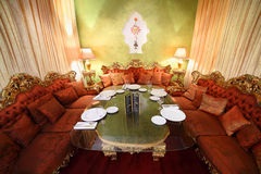 Table with serving and sofas in eastern restaurant Stock Photos