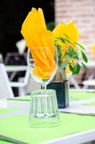 Table serving with wine glasses. And bright napkins in street cafe stock images