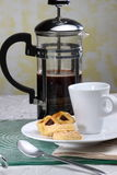 Table Set. Coffee on a table with a cup and couple of cakes / snacks Royalty Free Stock Photos