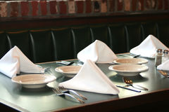 Table Set. Restaurant table set with plates, utensils and linen napkins royalty free stock photos