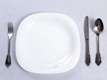 Plate and cutlery set Stock Photo
