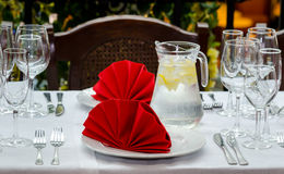 Table set. With red napkins and glass jug stock photos